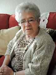 Scottish Portrait 1 (Reid Kerr Scotland) Tags: portrait glasses sittingdown grandmother jewellery granny cardigan greyhair