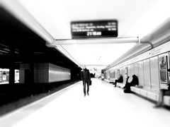 Ninety eight. Commute (sarahjanequinn) Tags: city travel people blackandwhite glasgow platform railway iphone project365