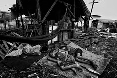 Ulingan, Tondo in Manila - We all need rest but some have too little comfort (Mio Cade) Tags: poverty boy children kid bed factory break child sleep philippines charcoal manila rest comfort landfill dumpsite tondo ulingan