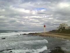 Umhlanga Rocks Lighthouse (Rckr88) Tags: ocean travel sea sky lighthouse water southafrica waves cloudy durban umhlanga blinkagain