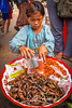 Girl-in-Cambodian-Market-Selling-Fried-Crickets (Captain Kimo) Tags: portrait food girl insect khmer market culture cricket friedshrimp singleexposurehdr cambodain