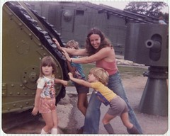 The 1970s - Mum & Kids pushing a WWI tank (TempusVolat) Tags: mum mother 1970s seventies 70s youngmum kids wwi tank tempusvolat tempus volat mrmorodo gareth scan scanned epson perfection v200 scanner goodlooking attractive scanning scans photoscanner epsonperfection dad parents mumdad father pat patricia roy geotagged garethwonfor mr morodo