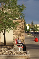 A moment in time   161/365 (E-Wiskr) Tags: bench reading parkinglot solitude books target anotherworld streetshot bouldercolorado amomentintime redandread