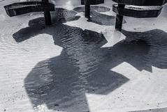 Crashing Slow (Anthony Pallotto Photography) Tags: city shadow urban bw white black reflection water fountain germany landscape outdoors bavaria town photo nikon waves picture falling wishes ripples wish dslr pillars pennies dripping schweinfurt basins kylesa d7000 crashingslow