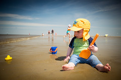 SOS. (whooosh.) Tags: boy sea beach water clouds toys coast kid sand toddler shore northsea bathing blusky ording sanktpeterording