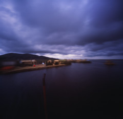 Leaving the Floating Islands ( PTO) Tags: travel sky lake 120 6x6 film peru uros titicaca water america islands boat long exposure purple image altitude south dramatic pinhole zero isla puno obscura uro