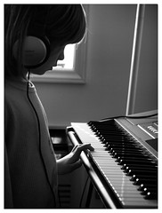 Make a Sound (daveelmore) Tags: family bw copyright music blackwhite keyboard sound allrightsreserved mydaughter lumixleicadgmacroelmarit45mm128 daveelmore