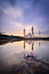 morning bloom (azrudin) Tags: travel blue light portrait sky panorama cloud sun lake flower reflection tree art nature water silhouette architecture sunrise landscape photography mirror still nikon cityscape slow mosque filter malaysia slowshutter bloom kualalumpur dri masjid scapes graduated shahalam longexposures digitalblending 10stop graduatedfilter sifoocom rgnd nikon1024 azrudin
