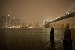 """Across The East River"" (Yale Gurney Photography) Tags: nyc snow ny skyline brooklyn night buildings river lights manhattan snowstorm brooklynbridge eastriver seaport buoy verizon"