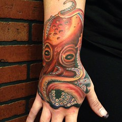 octopus arm hand tattoo by Wes Fortier - Burning Hearts Tattoo Co. 1430 Meriden Rd.  Waterbury, CT