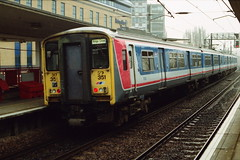19910323 003 Potters Bar. NSE Liveried Class 317, 317351 With A Kings Cross Train (15038) Tags: electric br trains emu railways britishrail pottersbar class317 317351