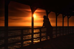 a thing of beauty, is a joy forever - 11/12 (Bec .) Tags: ocean sunset love water canon lol watching silhouettes bodylanguage romance lovers adelaide 1855mm southaustralia keats nd8 450d grangebeachjetty