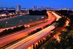 parallel streams (Rebecca Ang) Tags: city light urban architecture buildings pie lights twilight highway singapore cityscape trails freeway highways lighttrails lamps bluehour thebluehour urbanarchitecture panislandexpressway rebeccaang twilightography