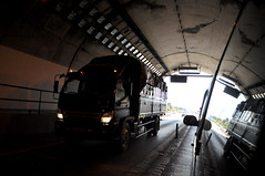 Light at the end of the tunnel (Roving I) Tags: vietnam highways trucks transports tunnels entrances langco