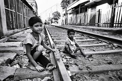 Kolkata - tenderness (daniele romagnoli - Tanks for 12 million views) Tags: street railroad blackandwhite bw india monochrome children monocromo nikon asia bambini kinder sguardo indie enfants sweetness kolkata indien bianconero calcutta dolcezza tenderness slum biancoenero slums inde ferrovia  calcuta sguardi indija  tenerezza d810   indiadelnord
