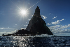 Ball's Pyramid silhouette (NettyA) Tags: ocean sea sun water rock clouds australia nsw sunburst day7 volcanic unescoworldheritage seastack lordhoweisland 2016 lhi ballspyramid janetteasche lordhoweforclimate