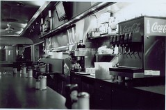 Shiny Stainless at 6AM (Stephen Hilton) Tags: bw blackwhite diner fp4 canonetgiiiql17