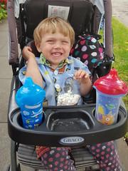 Enjoying popcorn (quinn.anya) Tags: sam toddler waterbottle popcorn stroller smile