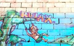 Relax (Georgie_grrl) Tags: toronto ontario man dinner relax fun graffiti mural harlem swing patio queenstreetwest tgif andthatsanorder haveagreatweekendyall elicsr hangingoutwithmondo