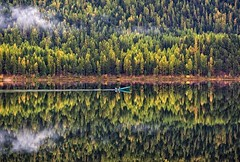 Gone Fishing (Philip Kuntz) Tags: autumn fall reflections boat fisherman bravo montana fallfoliage explore fisher larches salmonlake tamaracks