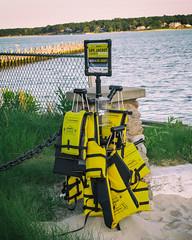 Life jackets (bratli) Tags: lifejackets beach yellow founderslanding southold ny northfork longisland saftey water