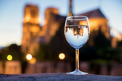 Notre-Dame in a glass (David Bertho) Tags: sunset summer paris france color reflection tourism water glass zeiss french colorful wine bokeh sony depthoffield notredame reflected refraction bluehour alpha a7 parisian refracted 2470