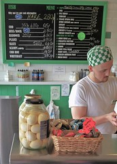 Fish & Chips & All The Extras. (ManOfYorkshire) Tags: fishchips takeaway bexhill sussex minnieberthas traditional chippy pickled eggs sauces hake huss rock cod skate haddock plaice scampi chips fish burgers counter staff guy clean menu vinegar service salt signs hat cover green check jar basket