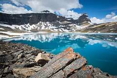 Cobalt Caldron (Darren Umbsaar) Tags: park blue cloud sun mountain lake canada mountains reflection water creek rockies waterfall view cloudy rocky sunny canadian boulder hike glacier mount alpine national scree banff tarn slope moraine scramble caldron glacial peyto