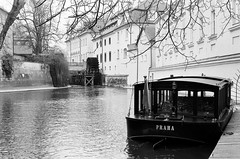 wanna cruise? (kishjar?) Tags: film river boat spring prague praha zuiko vltava watermill