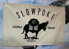 Slowpoke banner (Golden West Sign Arts) Tags: california losangeles burro handpainted eastbay southwestern slowpoke goldenwest signpainter paintedbanner califo goldenwestsignarts slowpokeleather