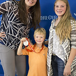 """<b>Aquatic Center Dedication of Service_100413_0223</b><br/> Photo by Zachary S. Stottler Luther College '15  Above: Christine Magnuson, two time Olympic Silver Medal winner, poses with various fans at the Luther College Service of Dedication for the new Aquatic Center.<a href=""""http://farm8.static.flickr.com/7446/10096083243_15d1b88771_o.jpg"""" title=""""High res"""">∝</a>"""