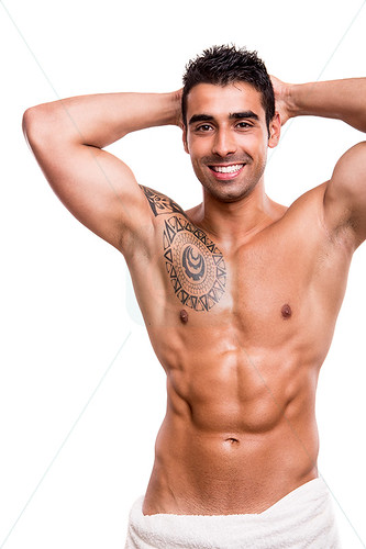 Attractive man posing with a white towel