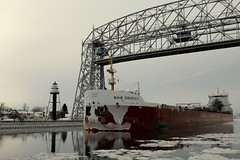Going Under (rcollins42) Tags: bridge winter sunset lake snow cold minnesota lights evening boat ship lift under going cargo duluth 2014 reidcollins rcollins42