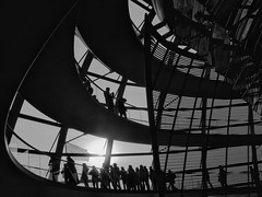 The Dome (Georgie Pauwels) Tags: city travel shadow people urban blackandwhite bw berlin monochrome stairs germany dark shadows walk candid citylife olympus reichstag dome moment