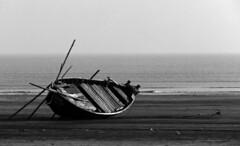 The wait (Satabdi Datta) Tags: sea bw water monochrome coast boat stranded westbengal greatphotographers flickraward5
