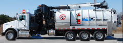 Tank Truck That Has Flashing LIghts and Street Sweeper Brushes On It (arlenomalley) Tags: streetsweeper flashinglights vacuumtruck streetsweepertanktruck