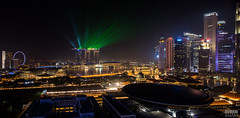 Marina Bay Light Show (davidgevert) Tags: longexposure panorama singapore cityscape shift ferriswheel lighttrails lightshow d800 singaporecityscape marinabay tiltshift travelphotography nightcityscape singaporeflyer marinabaysands nikond800 nighttimecityscape nikon24mmf35pce shiftpanorama davidgevert gevertphotography