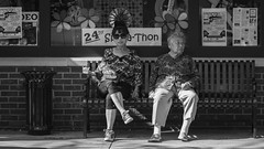 Made in the shade (SauceyJack) Tags: street people blackandwhite bw monochrome canon bench person blackwhite illinois women downtown sitting may streetphotography monochromatic sit naperville 2016 downtownnaperville lrcc 7020028isiil sauceyjack lightroomcc canon1dxmarkii canon1dxmark2