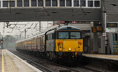 Class 87 n0 87002 heads through Newark Northgate on a very wet 10-05-2016 with a Kings Cross to Newcastle Charter (kevaruka) Tags: england color colour wet colors rain station yellow composition train canon spring flickr colours rainyday transport may rail railway windy trains trainstation 5d locomotive newark railtour frontpage dull britishrail nottinghamshire charter 2016 class66 drearyday networkrail class87 newarknorthgate 87002 canon5dmk3 5dmk3 5d3 5diii thephotographyblog canon70200f28ismk2 canoneos5dmk3 ilobsterit