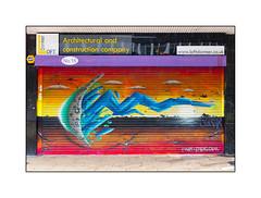 Graffiti (Van Dali), South London, England. (Joseph O'Malley64) Tags: uk greatbritain england streetart london wet rain shop graffiti mural paint britain spray signage shutter british cans aerosol southlondon shopfront cladding burglaralarm muralist wetweather vandali rollershutter funkyletters hexagonalpaving