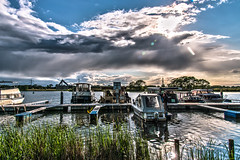 harbour's evening mood (bocero1977) Tags: blue trees light sunset sky sun lake reflection green nature water colors grass clouds germany landscape boats evening ship sundown harbour yacht outdoor boardwalk hdr