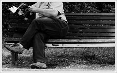 the secret weapon (baerophoto) Tags: street bench book blackwhite emptiness schwarzweis