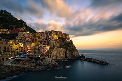 Clinging to the rocks (Daniele Bisognin) Tags: old sunset sea sky italy seascape water clouds harbor boat rocks village liguria cinqueterre