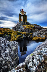 Hidsneset Lighthouse (Usstan) Tags: winter sky lighthouse reflection water norway clouds reflections lens landscape norge nikon rust rocks shadows seasons no serene rough nikkor westcoast sande locations costal sunnmre mreogromsdal hidsneset 1685mm d7000