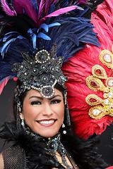 Brazilian Samba Dancer (wyojones) Tags: houston downtown texas texaslunarfestival cityhall hermannsquare brazil woman brunette beauty beautiful lovely pretty graceful smile feathers headress earrings necklace portrait outdoor wyojones