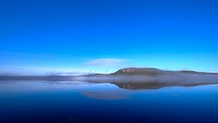 Blue mirage (jarnasen) Tags: morning blue sky panorama copyright cloud mist lake mountains nature water fog reflections landscape early scenery sweden outdoor tripod wideangle sverige scandinavia jmtland lakescape xt1 nordiclandscape fujifilmxt1 xf1024mmf4 jarnasen jrnsen skrvngssjn