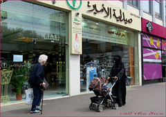 `1704 (roll the dice) Tags: london westminster w2 arab muslim islam scared creepy paddington marylebone burka veiled dark black niqab hijab arabic fashion shops shopping people eyes natural streetphotography uk art classic urban england unaware unknown sad mad funny strangers portrait candid canon tourism woman stick slow pensioner opposites madness happy pram baby council edgwareroad bags londonist oil kuwait veil pretty sexy girl society culture mob