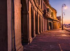 Havana Arches (Geoff Livingston) Tags: light orange sunrise rust arch cuba malecon pillars