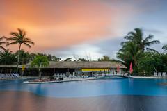 Soft mirror (ivgmarc) Tags: deville piscina swimingpool hotel sunset puesta sol larga exposicin palmera salvador bahia brasil
