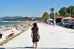 Samil (javiercbugarin) Tags: summer beach girl walking holidays young playa paseo vigo martimo samil